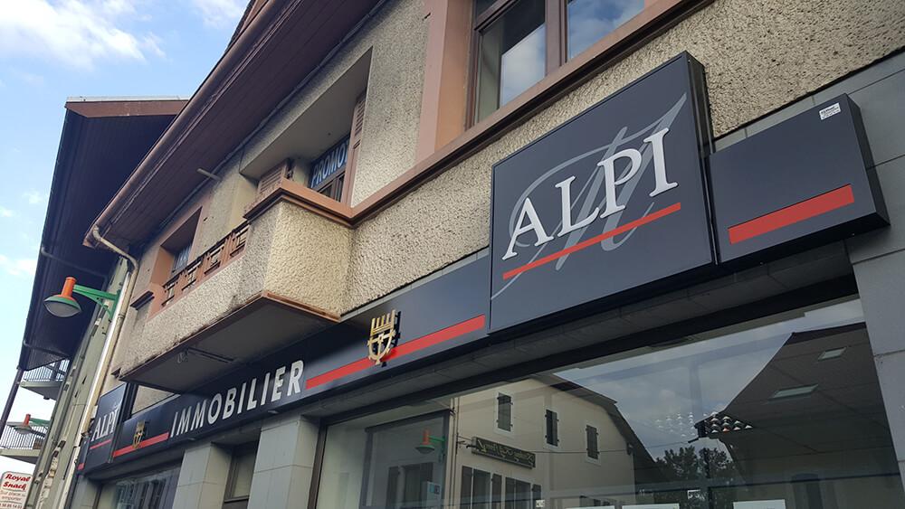 Création & installation de caissons lumineux pour ALPI Immobilier