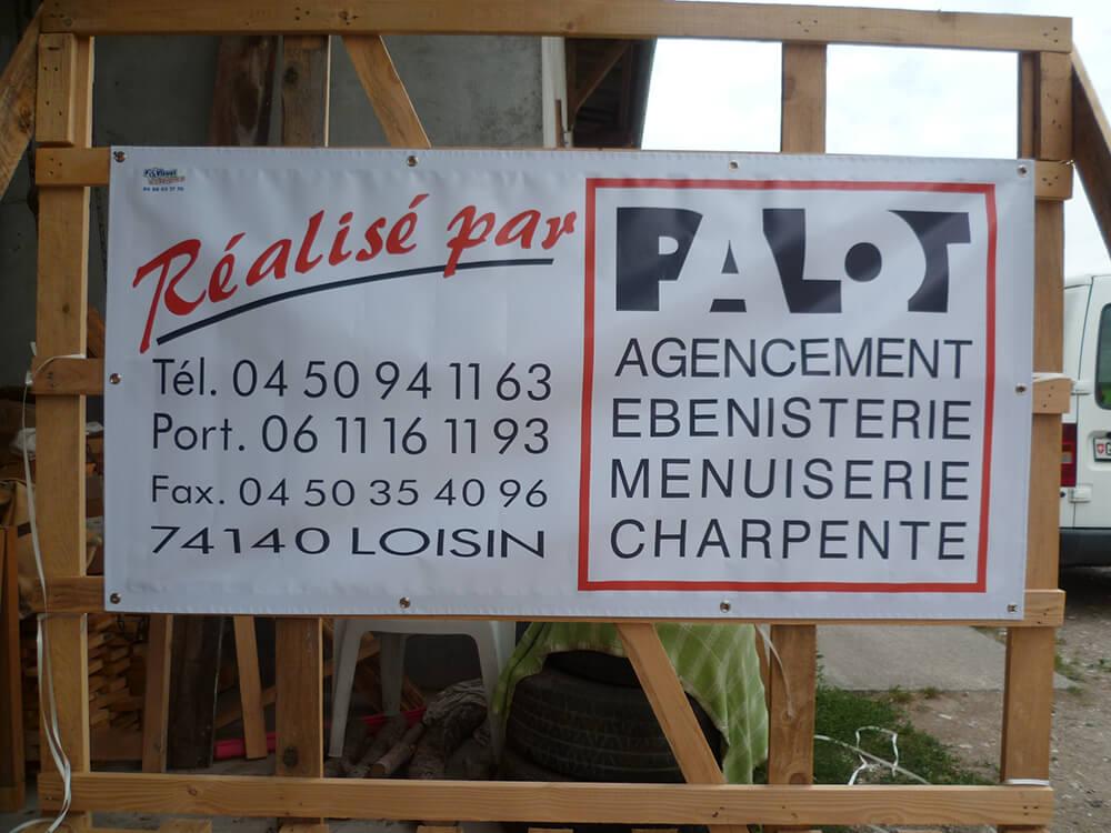 Création & installation de banderoles pour un menuisier